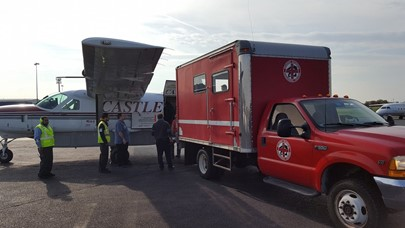 Loading loggerhead onto Castle Aviation plane